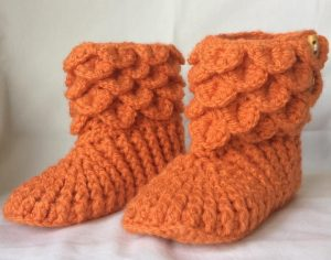 Crochet booties in orange