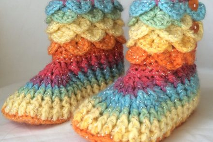 Crochet baby booties in sparkly varigated yarn