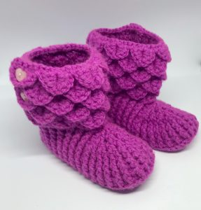 Crochet booties in fuchsia pink